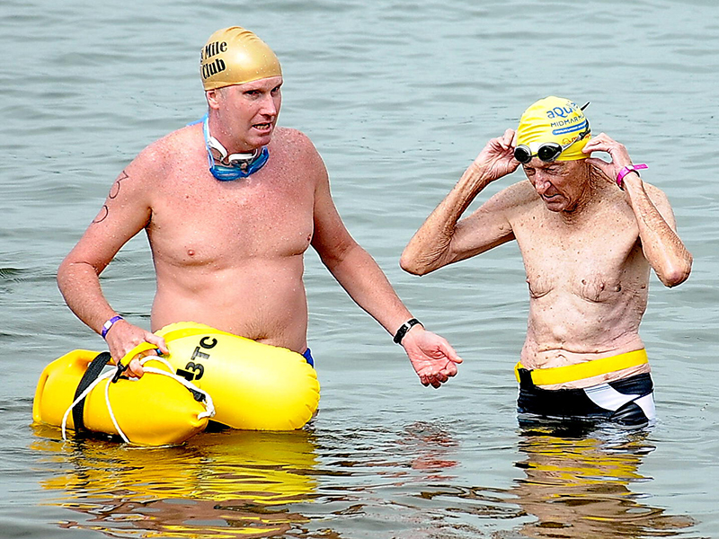 "aQuellé Midmar Mile icon Mike ""Buthy"" Arbuthnot swam the Mile for the 46th time, and was happy to represent The Cows as a fundraiser for the CHOC Childhood Cancer Foundation of SA. Photo: Jetline Action Photo"